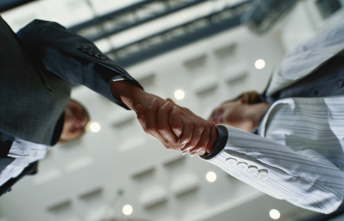 Business-Handshake-Meeting-Deal-Low-Angular-700x450.jpg