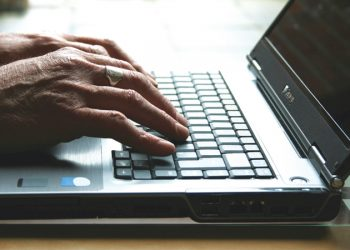 laptop-keyboard-hands-elderly-pensioner-700.jpg
